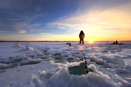 Ice Fisher at Sunset Patiently Waiting
